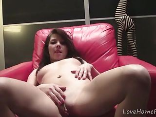 Teen lays down and spreads her legs