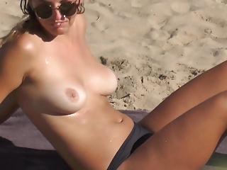 young model topless beach shower sunbathing sunglasses
